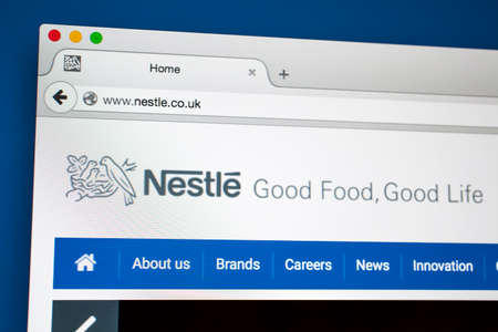 vevey: LONDON, UK - OCTOBER 21ST 2015:The homepage of the official Nestle website, on 21st October 2015.  Nestle is a Swiss food and beverage company based in Vevey, Switzerland.