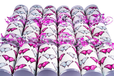 central chamber: A studio shot of Crackers or otherwise known as Bon Bons.  A traditional cracker consists of a cardboard tube wrapped in a brightly decorated twist of paper with a gift in the central chamber.