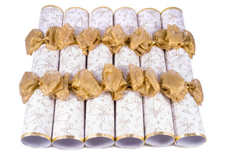 central chamber: A studio shot of Christmas Crackers or otherwise known as Bon Bons.  A traditional cracker consists of a cardboard tube wrapped in a brightly decorated twist of paper with a gift in the central chamber. Stock Photo