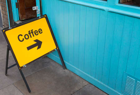 need direction: A sign displaying the direction for people who need a coffee.