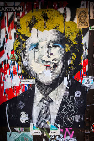 monroe: LONDON, UK - JANUARY 13TH 2016: Urban street art by artist Cartrain portraying a pop-art style image of George Bush with a Marilyn Monroe hairstyle in East London, on 13th January 2016. Editorial
