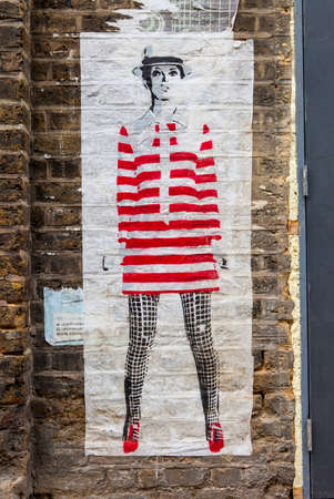 sixties: LONDON, UK - JANUARY 13TH 2016: A piece of urban street art portraying an image of sixties icon and model Twiggy, in East London on 13th January 2016.
