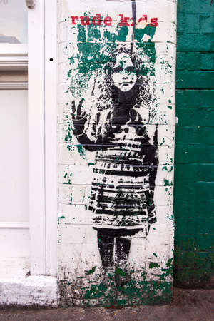 misbehave: LONDON, UK - JANUARY 13TH 2016: Rude Kids Graffiti in East London, on 13th January 2016.
