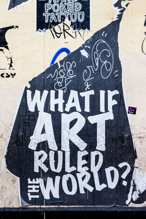 what if: LONDON, UK - JANUARY 13TH 2016: A piece of urban street art asking �what if art ruled the world?, in London on 13th January 2016.