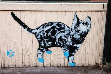 都市ロンドンで猫の落書き。