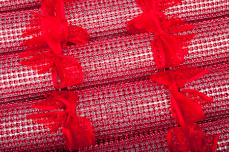 central chamber: A studio close-up shot of a set of Crackers - otherwise known as Bon Bons.  A traditional cracker consists of a cardboard tube wrapped in a brightly decorated twist of paper with a gift in the central chamber.