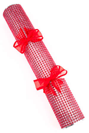 central chamber: A studio shot of a Crackers or otherwise known as a Bon Bon.  A traditional cracker consists of a cardboard tube wrapped in a brightly decorated twist of paper with a gift in the central chamber.