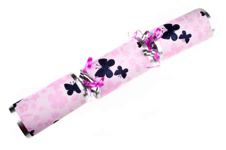 central chamber: A studio shot of a traditional Cracker or otherwise known as a Bon Bon.  A traditional cracker consists of a cardboard tube wrapped in a decorated twist of paper with a gift in the central chamber.