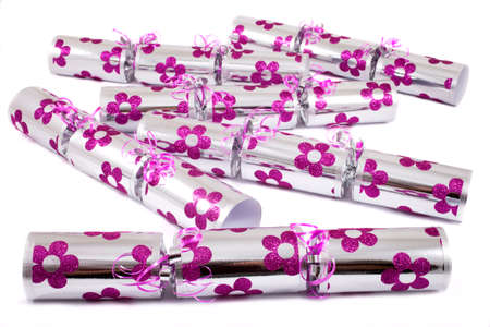 central chamber: A studio shot of Crackers or otherwise known as Bon Bons. A traditional cracker consists of a cardboard tube wrapped in a decorated twist of paper with a gift in the central chamber.