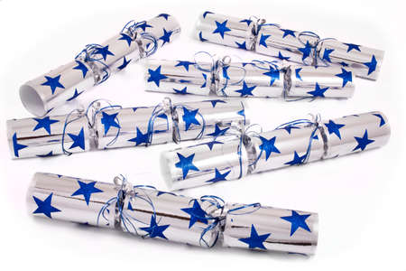 central chamber: A studio shot of a set of Crackers or otherwise known as Bon Bons. A traditional cracker consists of a cardboard tube wrapped in a decorated twist of paper with a gift in the central chamber. Stock Photo