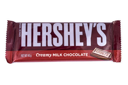 hershey's: LONDON, UK - JANUARY 4TH 2017: A studio shot of a Hersheys Creamy Milk Chocolate Bar, isolated over a plain white background, on 4th January 2017.  Hersheys is one of the largest chocolate manufacturers in the USA. Editorial
