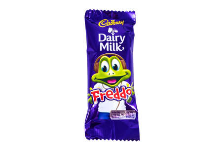 fredo: LONDON, UK - JANUARY 4TH 2017: An unopened Freddo Dairy Milk chocolate bar manufactured by Cadbury, pictured over a plain white background on 4th January 2017.