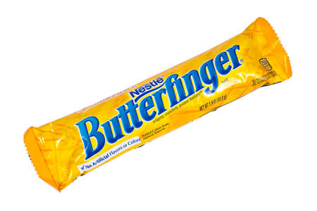 LONDON, UK - JANUARY 4TH 2017: A studio shot of a Butterfinger chocolate bar isolated over a plain white background, on 4th January 2017.  The product is manufactured by Swiss company Nestle.