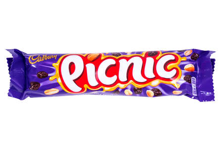 LONDON, UK - JANUARY 4TH 2017: An unopened Picnic chocolate bar manufactured by Cadbury, pictured over a plain white background on 4th January 2017.