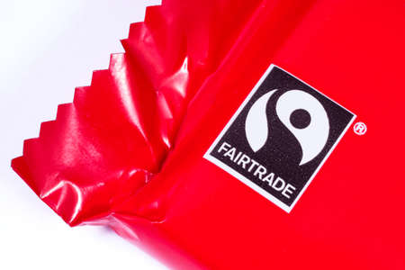 fairtrade: LONDON, UK - JANUARY 4TH 2017: A close-up shot of the Fairtrade logo on a food product, on 4th January 2017.  Fair trade help producers in developing countries achieve better trading conditions and promote sustainability.