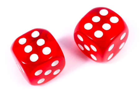 Two red dice isolated over a plain white background.