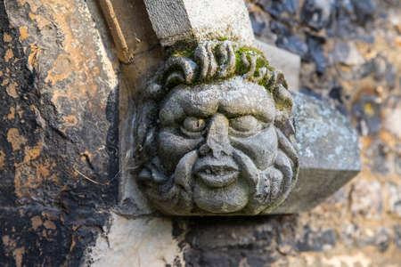 A gargoyle on the exterior of Waltham Abbey Church in Waltham Abbey, Essex.