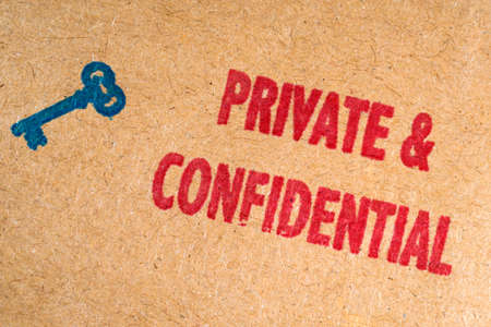 conceal: A close-up of the Private and Confidential Rubber Stamp on an enevlope.