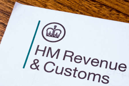 customs official: LONDON, UK - JANUARY 13TH 2017: The logo of Her Majestys Revneue and Customs on a piece of paper, on 13th January 2017.  HMRC is a non-ministerial dept of the UK Government.
