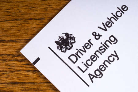 LONDON, UK - JANUARY 13TH 2017: The logo for the Driving and Vehicle Licensing Agency on the corner of a leaflet, on 13th January 2017.