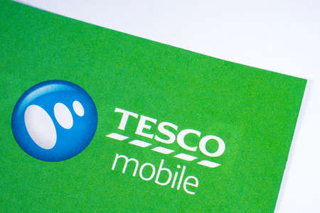 LONDON, UK - JANUARY 13TH 2017: A close-up of the Tesco Mobile logo on a promotional leaflet, on 13th January 2017. Editorial