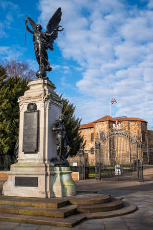 The magnificent Colchester War Memorial with Colchester Castle in the background, in Colchester, Essex.