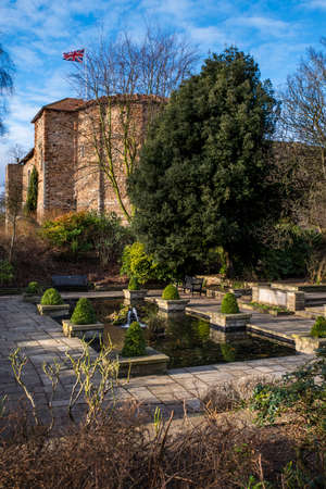 A view of a pond in Colchester Castle Park with the magnificent Colchester Castle in the background in Colchester, UK.