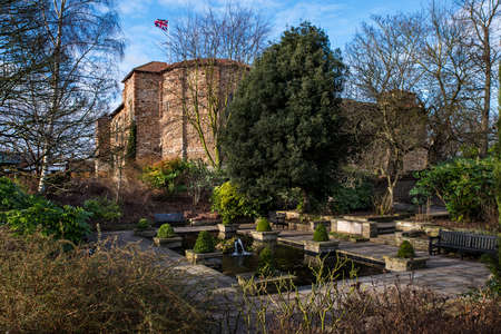A view of a pond in Colchester Castle Park with the magnificent Colchester Castle in the background, in Colchester, UK. Stock Photo