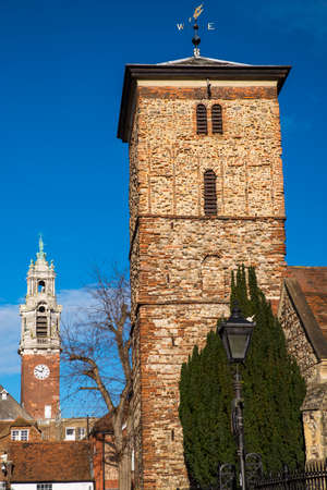 anglo saxon: A view of the old Saxon tower of the Holy Trinity church with the Victorian tower of Colchester Town Hall in the background, in the historic town of Colchester, Essex. Stock Photo