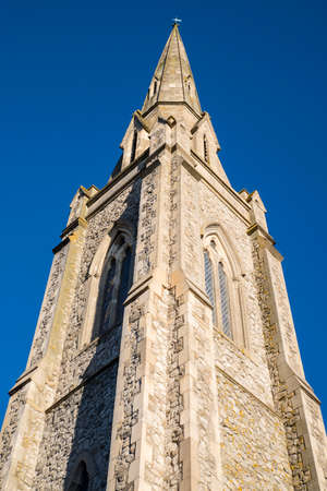 Looking up at the impressive tower of the Lion Walk United Reformed Church in Colchester, Essex.
