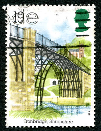 UNITED KINGDOM - CIRCA 1989: A used postage stamp from the UK, depicting an illustration of the historic Shropshire landmark - the Iron Bridge in the village of Ironbridge, circa 1989. Editorial
