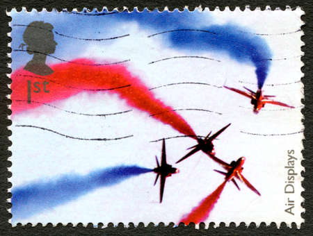 GREAT BRITAIN - CIRCA 2008: A used postage stamp from the UK, celebrating Air Shows by depicting an image of the Red Arrows display team, circa 2008.