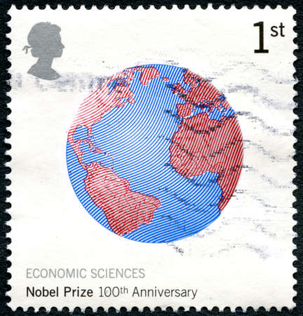 GREAT BRITAIN - CIRCA 2001: A used postage stamp from the UK, celebrating the 100th Anniversary of the Nobel Prize for Economic Sciences, circa 2001. Editorial