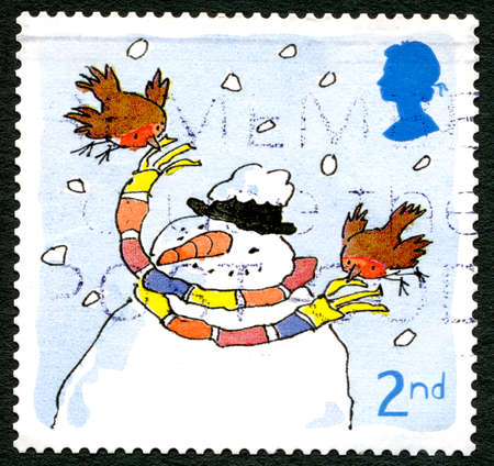 GREAT BRITAIN - CIRCA 2001: A used postage stamp from the UK, depicting a festive illustration of a Snowman and Robin, circa 2001. Editorial