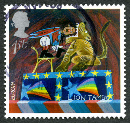 GREAT BRITAIN - CIRCA 2002: A used postage stamp from the UK, depicting an illustration of a Lion Tamer in a Circus, circa 2002.
