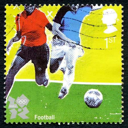 GREAT BRITAIN - CIRCA 2012: A used postage stamp from the UK, commemorating the football at the 2012 Summer Olympic Games held in London, circa 2012.