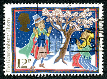 county somerset: GREAT BRITAIN - CIRCA 1986: A used postage stamp from the UK, depicting celebrating Christmas folk tradition with an illustration of the Glastonbury Thorn, circa 1986. Editorial