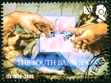 programme: GREAT BRITAIN - CIRCA 2005: A used postage stamp from the UK, celebrating The South Bank Show television programme then aired on the ITV channel, circa 2005. Editorial