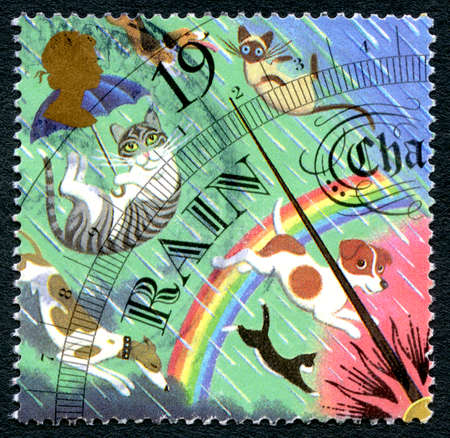 drizzling rain: GREAT BRITAIN - CIRCA 2001: A used postage stamp from the UK, depicting an illustration of a weather barometer showing rain, circa 2001.