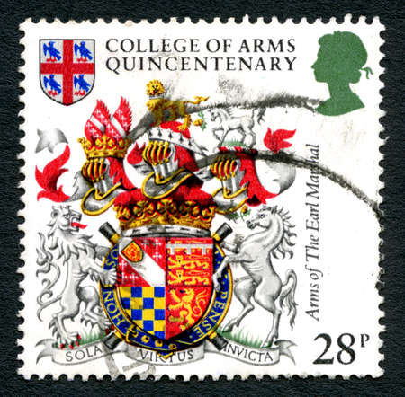marshal: GREAT BRITAIN - CIRCA 1984: A used postage stamp from the UK, depicting an illustration of the Arms of The Earl Marshal in celebration of the College of Arms Quincentenary, circa 1984.