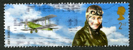 GREAT BRITAIN - CIRCA 2003: A used postage stamp from the UK, depicting an illustration of famous English aviator Amy Johnson who set numerous long-distance flight records, circa 2003. Editorial