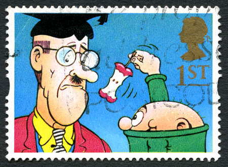 director de escuela: GREAT BRITAIN - CIRCA 2014: A used postage stamp from the UK, depicting a scene from the Bash Street Kids comic strip featured in the Beano comic, circa 2014.