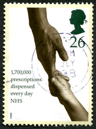 GREAT BRITAIN - CIRCA 1998: A used postage stamp from the UK, detailing the fact that the National Health Service dispense 1.7 million Prescriptions every day, circa 1998.
