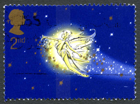 barrie: GREAT BRITAIN - CIRCA 2002: A used postage stamp from the UK, depicting an illustration of Tinkerbell from the Peter Pan story, circa 2002.