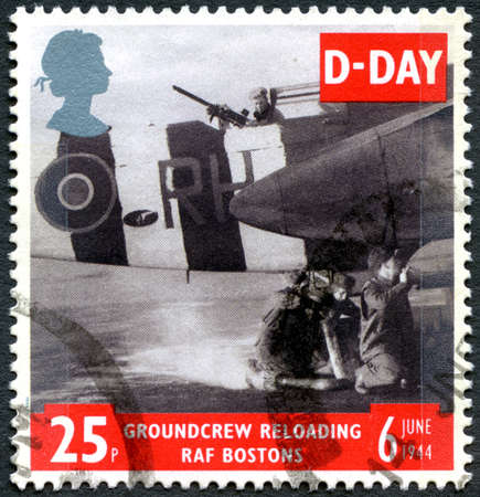 second world war: GREAT BRITAIN - CIRCA 1994: A used postage stamp from the UK, commemorating D-Day during the Second World War, circa 1994.  The image shows Ground Crew Reloading RAF Bostons. Editoriali