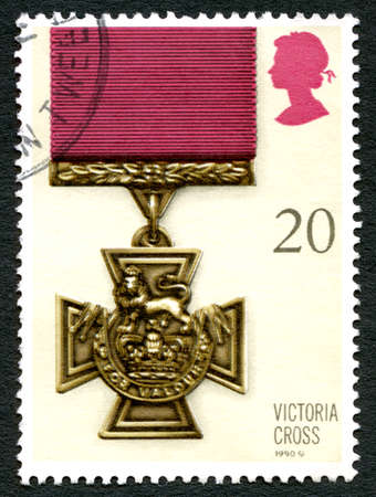 awarded: GREAT BRITAIN - CIRCA 1990: A used postage stamp from the UK, depictcing an illustration of a Victoria Cross medal - the highest award for gallantry, circa 1990.