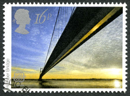 yorkshire and humber: GREAT BRITAIN - CIRCA 1983: A used postage stamp from the UK, depicting an image of the Humber Bridge in England, circa 1983.