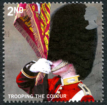 GREAT BRITAIN - CIRCA 2005: A used postage stamp from the UK, depicting a scene of a Queens Guard at a Trooping the Colour Ceremony, circa 2005. Editorial