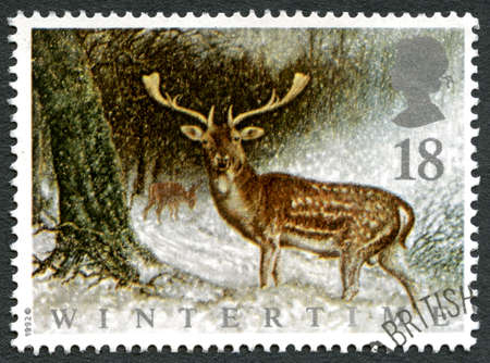 UNITED KINGDOM - CIRCA 1992: A used postage stamp from the UK, celebrating Wintertime with an illustration of a Deer amongst the snow, circa 1992. Editorial