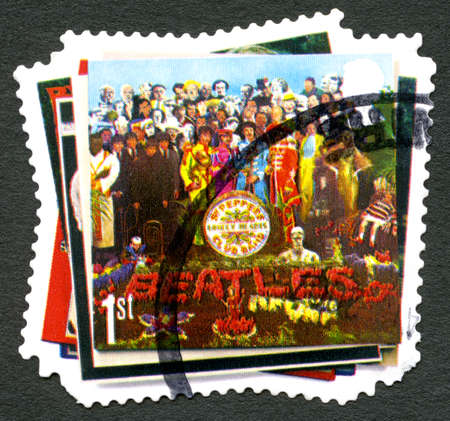 GREAT BRITAIN - CIRCA 2007: A used postage stamp from the UK, depicting the album cover of Sgt Peppers Lonely Hearts Club Band by The Beatles, circa 2007. Editorial